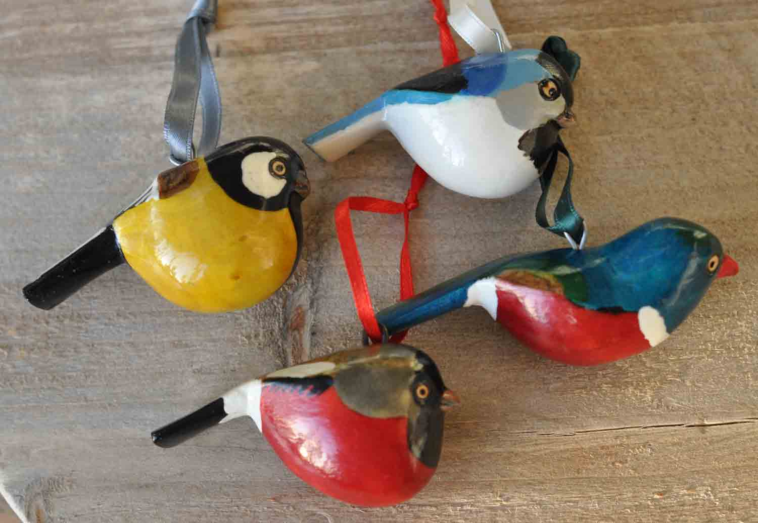 Set of four hand whittled and painted birds for Homeware accessories