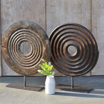 Stone Ore Disc Artwork On Stand With Concentric Circle Pattern