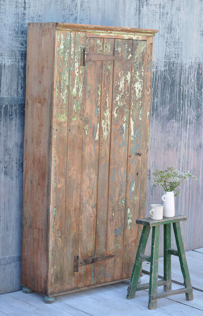 Vintage cupboard with rustic paintwork