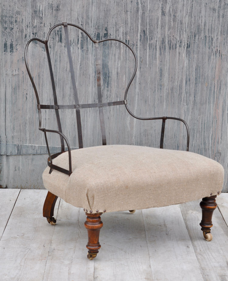antique deconstructed ironback arm chair