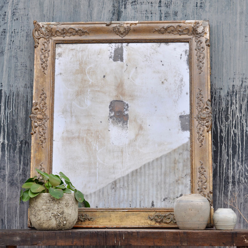 ornate french foxed antique mirror