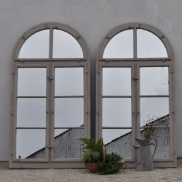 pair of arched architectural window mirrors