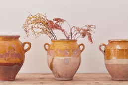 Antique French confit pot from Home Barn containing dried flowers