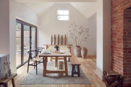 Home Barn's rustic wooden dining table and bench with vintage ceramics in a neutral scheme