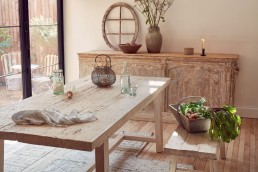 Home Barn's rustic wooden dining table, bench and sideboard add texture to a neutral palette