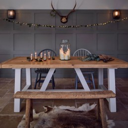 Rustic farm house table from Home Barn with bell jar filled with lots of candles and xmas decoration