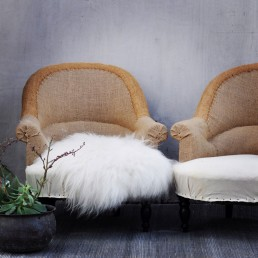 Home Barn's fluffy white sheepskin rug adds texture and cosiness to fireside armchairs at Christmas