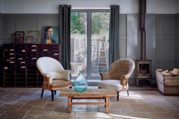 Vintage furniture from Home Barn Interiors with antique french armchair and rustic wood coffee table and antique drawers