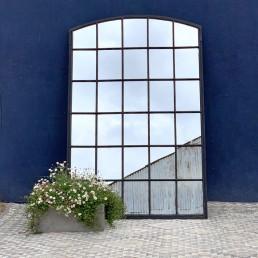 large industrial factory window mirror