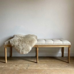Upholtered-Linen-Bench-With-Copper-Details